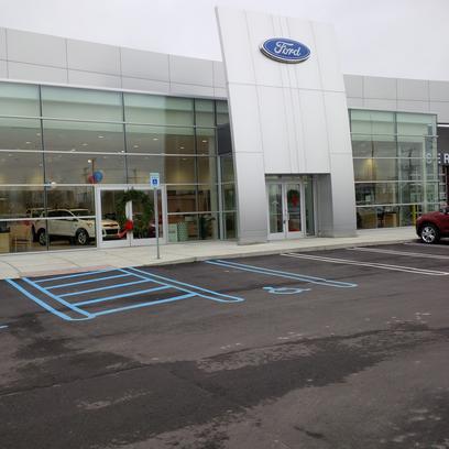 milnes ford car dealership in lapeer mi 48446 2668. Black Bedroom Furniture Sets. Home Design Ideas